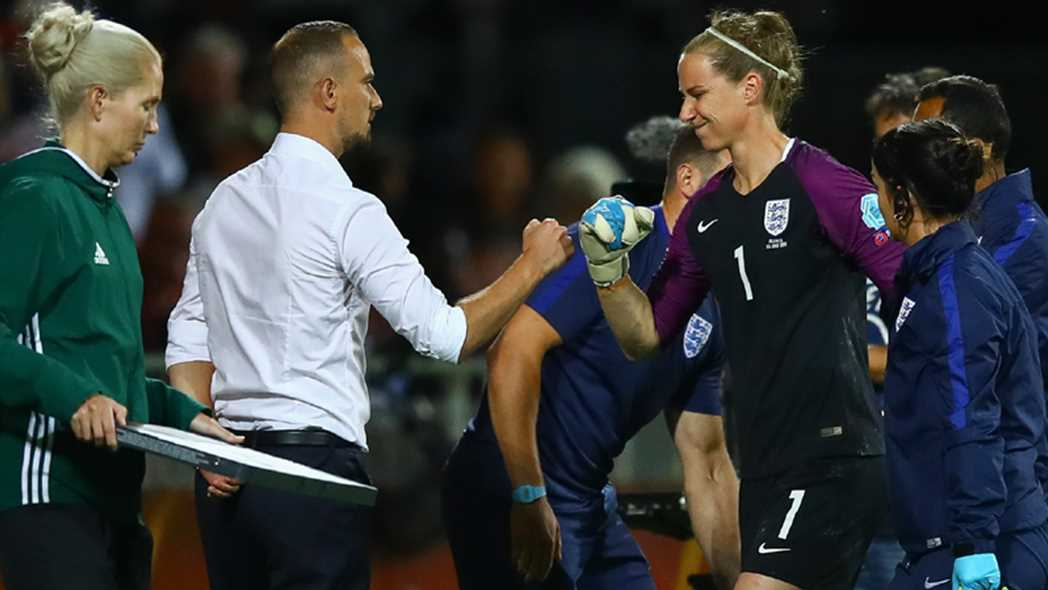 Karen Bardsley gets fist bump from England coach Mark Sampson after suffering injury in EURO quarters (photo: English FA)