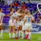 OL Reign players celebrate a goal