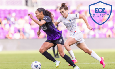 Orlando Pride forward Sydney Leroux running from a defender with the ball at her feet