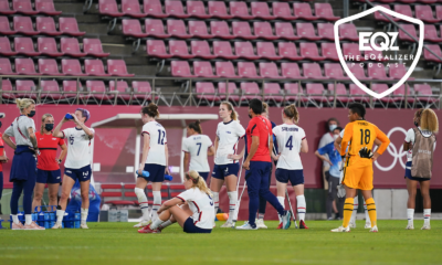 Members of the U.S. women's national soccer team stand on the field after their Olympic semifinal loss to Canada