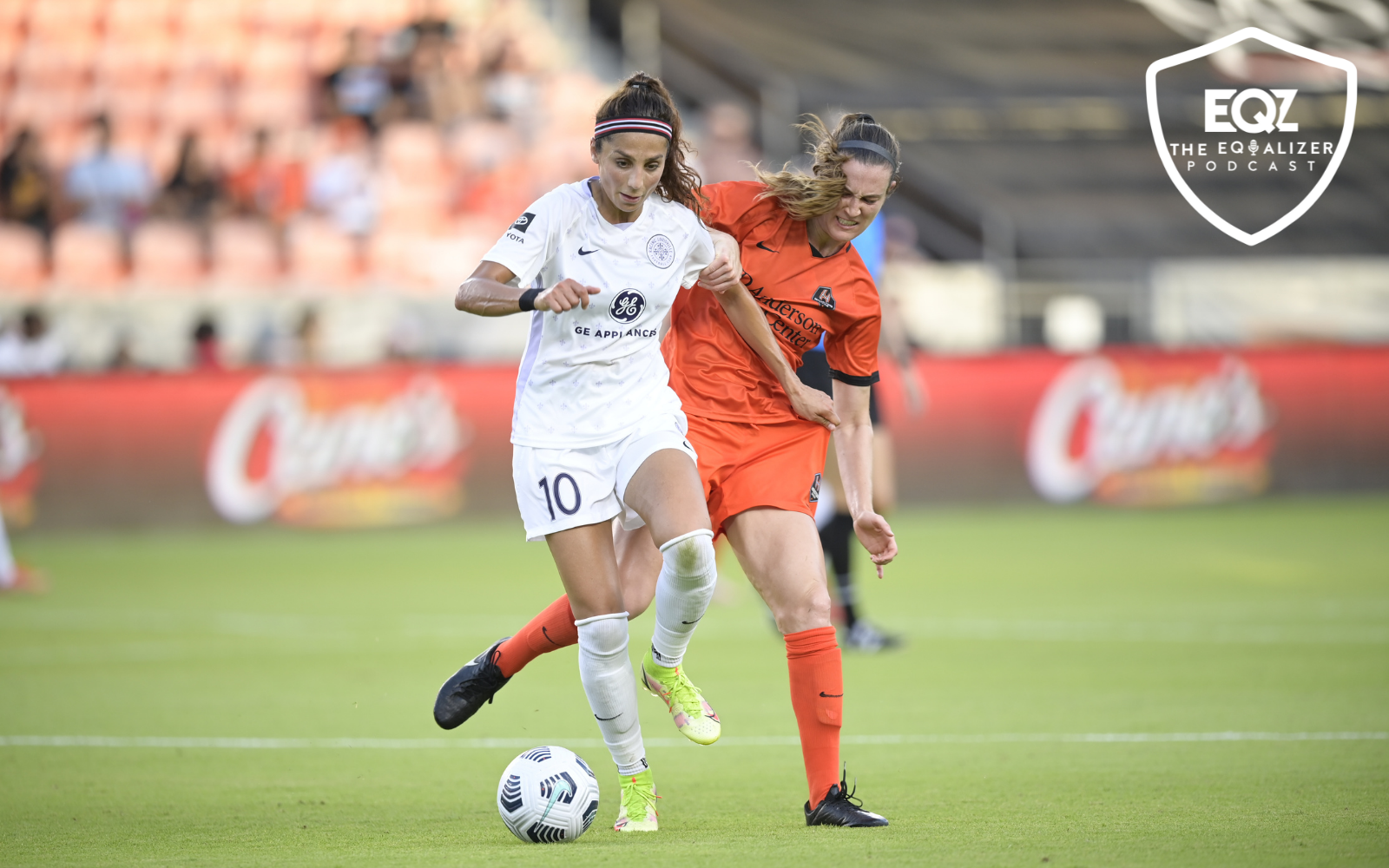 Racing Louisville FC forward Nadia Nadim dribbles the ball while Houston Dash player Katie Naughton defends.