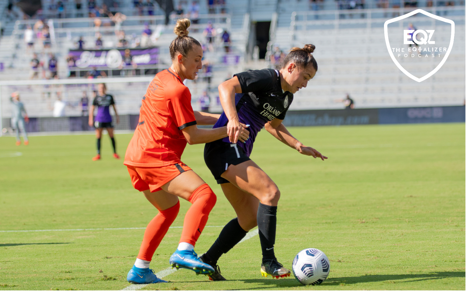 Orlando Pride defender Ali Riley dribbles the ball while defend by a player on the Houston Dash