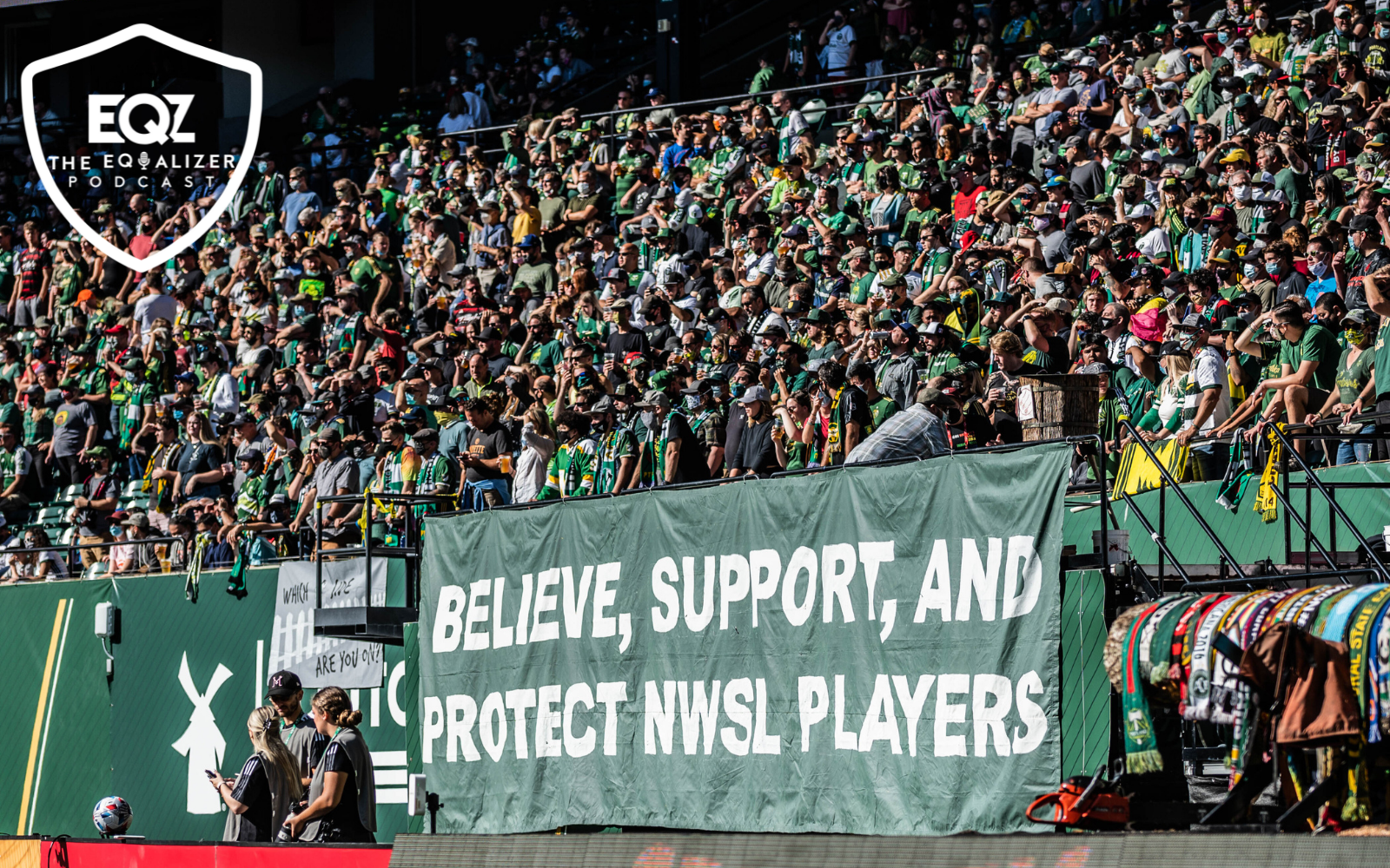 """Large banner at Portland Timbers game that reads: """"Believe, Support, and Protect NWSL Players"""""""