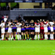 NWSL players from the Orlando Pride and Gotham FC gather at midfield in the sixth minute of Saturday's game